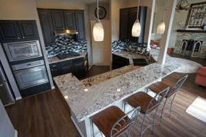 A newly renovated kitchen with dark cabinetry