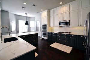 A newly renovated kitchen with two tone cabinetry.
