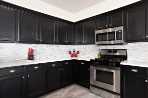 A newly renovated kitchen with dark cabinetry.